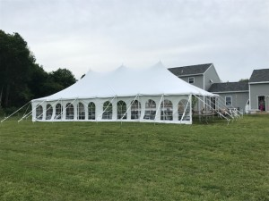 30x60 Pole Tent Package White Wood Poles (16) 60' Round Tables 128 Chairs (2) 8 foot Banquet Tables $1,150.00